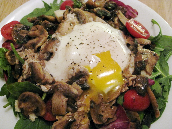 Sassy salad greens with poached egg and balsamic vinaigrette-sauteed mushrooms and grape tomatoes